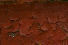 Треснутая краска на стене Старая предпосылка стены Firebrick Стоковые Фото