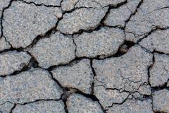 Треснутая поверхность гудронированного шоссе Стоковое Фото