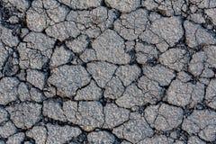 Треснутая поверхность гудронированного шоссе Стоковые Фотографии RF