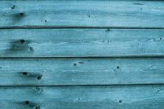 Треснутая старая бирюза и голубая краска на деревянной предпосылке стоковые фото