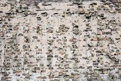 Треснутая черная кирпичная стена Стоковое Фото