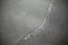 Треснутый темный шифер, каменная предпосылка стоковое фото