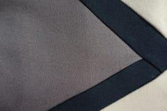 Триангулярный gusset серой ткани зашитый к бежевой и черной ткани Стоковое Фото