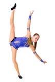 Трико разрабатывая, танцевать танцора красивого девочка-подростка спортсмена гимнаста нося голубое, делая тренировку изолировано Стоковая Фотография