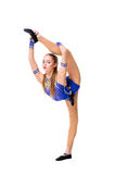 Трико разрабатывая, танцевать танцора красивого девочка-подростка спортсмена гимнаста нося голубое, делая тренировку изолировано Стоковое Фото