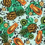 Троповая безшовная картина с экзотическими плодами и листьями иллюстрация штока