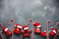 Тросточка конфеты предпосылки рождества, рождественская елка, звезда, шляпа santa Стоковое Изображение