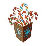 Тросточка конфеты рождества в коробке на белизне Стоковые Фото