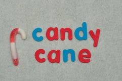 Тросточка конфеты слова с тросточкой конфеты Стоковая Фотография