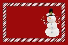 Тросточка конфеты с рамкой снеговика бесплатная иллюстрация
