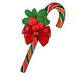 Тросточка рождества при красные ягоды изолированные на белизне. Стоковые Изображения
