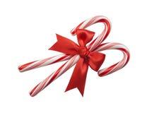 тросточки конфеты смычка красные стоковое изображение