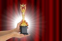 Трофей награды для достижения победителя стоковое фото
