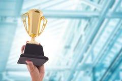 Трофей награды для достижения победителя стоковое изображение rf