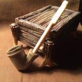 Труба и куря коробка Стоковая Фотография