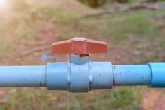 Труба клапана воды голубая в ферме Стоковая Фотография RF