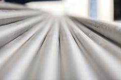 Труба inox металла на стоге стоковая фотография