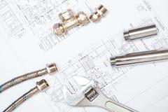 Трубопровод и чертежи, натюрморт конструкции стоковая фотография