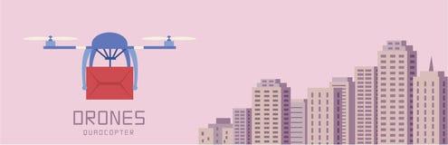Трутни воздуха нося картон, предпосылку городского пейзажа Стоковое Изображение