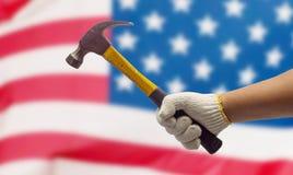 Трудовая рука на флаге США Стоковые Фотографии RF