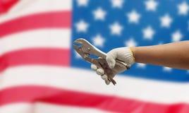 Трудовая рука на флаге США Стоковые Фото