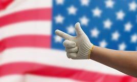 Трудовая рука на флаге США Стоковые Изображения