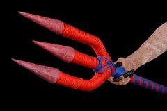 Трёхзубец в руке выдуманный быть Стоковая Фотография RF