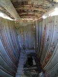 Туалет в деревне с отверстием в поле стоковые изображения
