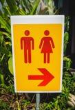 Туалет поет для человека и женщины на желтой таблице Стоковые Фотографии RF