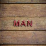 Туалет человека символический на деревянной предпосылке Стоковые Изображения RF