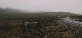 Туманное поле на горе Стоковая Фотография