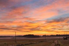 Туманное поле рано утром в осени Стоковое фото RF