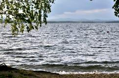 Туманный далеко берег озера Стоковое фото RF
