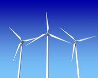 Турбины генератора ветра над голубым небом Стоковые Изображения