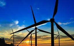 Турбины генератора ветра на заходе солнца Стоковое Фото