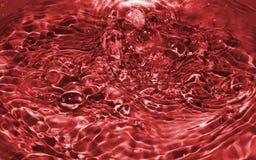 Турбулентный красный цвет воды Стоковая Фотография RF
