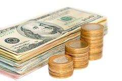Турецкие монетки и банкнота доллара на белой предпосылке Стоковые Фото