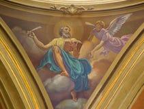 ТУРИН, ИТАЛИЯ - 13-ОЕ МАРТА 2017: Фреска St Matthew евангелист в куполке Церков Chiesa di Santo Tommaso c Secchi стоковое фото