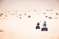 Туристы ехать велосипеды квада Стоковая Фотография
