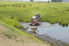 Туристы на Мотовездеходах На ATV Стоковая Фотография RF