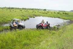Туристы на Мотовездеходах На ATV Стоковые Изображения RF