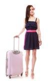 Турист девушки брюнет женский в платье с чемоданом Туризм перемещения Стоковое Изображение RF
