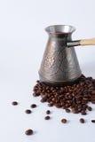 Турок и кофейные зерна стоковое фото