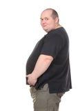 Тучный человек стоя в профиле и держа ее живот Стоковая Фотография RF