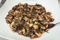 Тушёное мясо гриба с петрушкой и полентой Стоковая Фотография