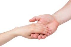 тщательно женская рука держит человека s Стоковое Фото