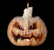 Тыква и свечка Halloween на верхней части Стоковые Фото