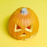 Тыква хеллоуина на желтом цвете Стоковая Фотография