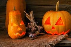 Тыква хеллоуина на старой деревянной предпосылке Стоковое Фото