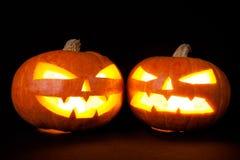 Тыквы хеллоуина усмехаются и страшные глаза на ноча партии Стоковые Изображения